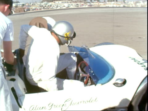 race car driver jim clark steering stopping lotus 40 ford in pit alley at riverside international raceway jim clark talking with crew then chatting... - tartan stock videos & royalty-free footage