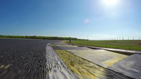 race car driving on a race track - sports track stock videos & royalty-free footage