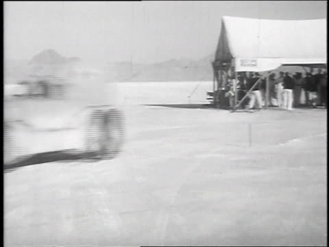 race car leaving tent / car racing across the salt flats - bonneville salt flats stock videos and b-roll footage