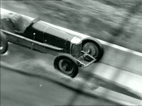 B/W 1927 race car on fire going down ramp at Indianapolis 500 / documentary
