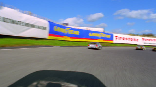 Race car point of view with cars racing on track / crashing + turning over (remote control cars)