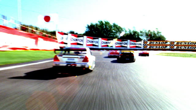 OVEREXPOSED race car point of view with other cars racing on track (remote control cars)