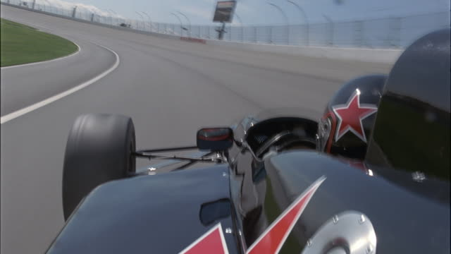 A race car speeds around a track.