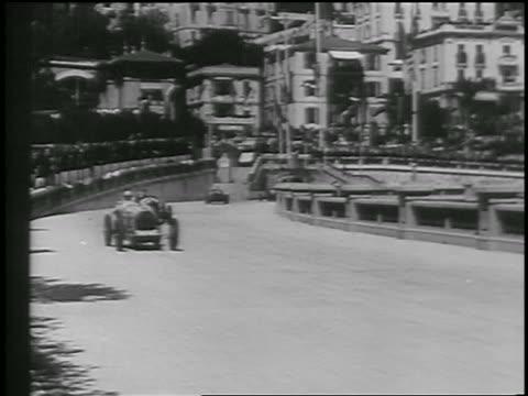 b/w 1933 race cars rounding curve in monaco grand prix race / monte carlo - monte carlo stock videos & royalty-free footage
