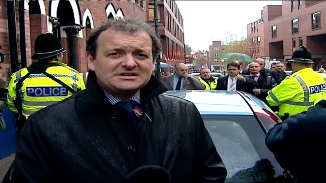nick griffin and mark collett found not guilty west yorkshire leeds leeds crown court ext reporter to camera with griffin and collett in background - griffin stock videos & royalty-free footage