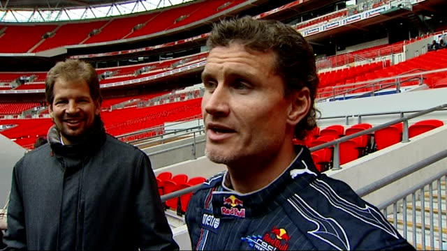 vidéos et rushes de 'race of champions' preview press conferences and test drive with david coulthard ext david coulthard speaking to man / david coulthard interview sot... - essai de voiture