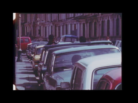 race relations; itn lib tx 17.6.76 england: london: brixton ext street; pull out to show dustbins, etc black women at doorway. houses black children... - playing stock videos & royalty-free footage