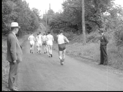 b/w 1934 montage ms race walkers competing on rural road, winner giving speech to microphone then walking off, oregon, usa - racewalking stock videos and b-roll footage