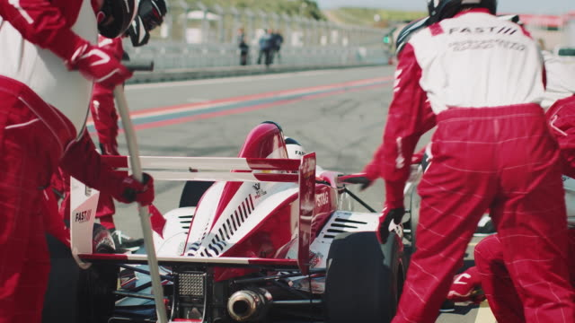 racecar leaving from pit stop after maintenance - pit stop stock videos & royalty-free footage