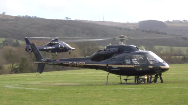 racegoers arrive by helicopter at the helipad close to the cheltenham racecourse on march 16 2018 in cheltenham england today is the final day of the... - cheltenham racecourse stock videos and b-roll footage