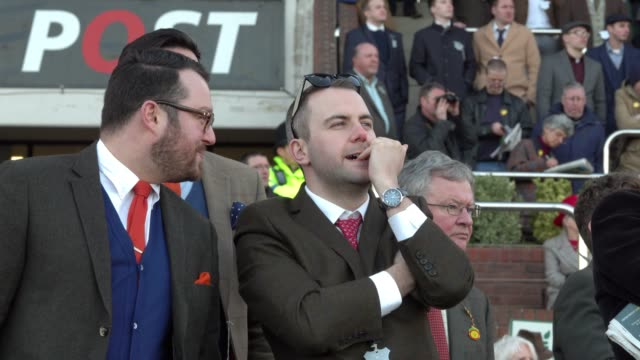 racegoers watch the racing at cheltenham racecourse on march 13 2018 in cheltenham england thousands of racing enthusiasts are expected at the... - cheltenham racecourse stock videos and b-roll footage