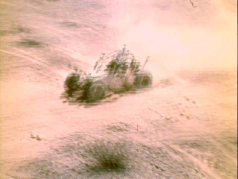 racemodified volkswagen beetle pulling from startling line of mexican 1000 desert race held in baja mexico / aerial tracking shot of chevy pickup... - dune buggy stock videos and b-roll footage