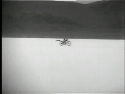 racer lying flat on motorcycle while racing to cut down on wind resistance / bonneville salt flats, utah, united states - 1958 stock videos & royalty-free footage