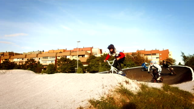 HD SLOW MOTION: Racers Racing On Bmx Track