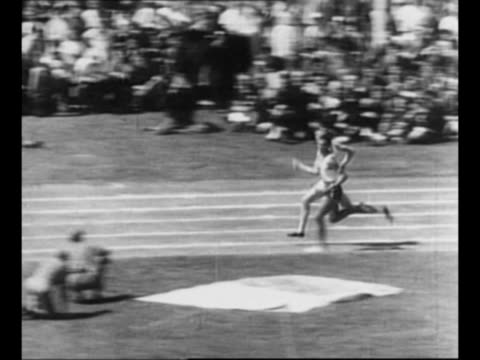 racers round curve at track race / roger bannister takes the lead in race passing a black runner / tiltdown shot bannister crosses finish line in... - bannister stock videos & royalty-free footage