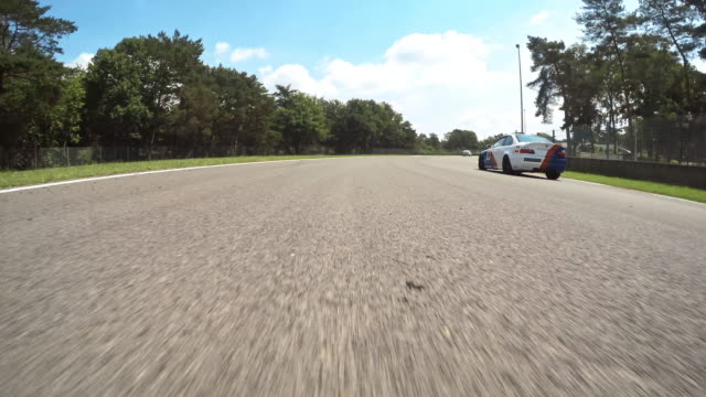 pov racetrack - pursuit sports competition format stock videos and b-roll footage