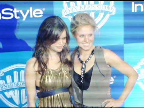 Rachel Bilson and Kristen Bell at the InStyle/Warner Brothers Golden Globes Party at the Beverly Hilton in Beverly Hills California on January 16 2006