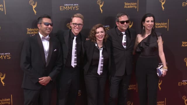 vídeos de stock e filmes b-roll de rachel bloom, adam schlesinger, kabir akhtar, and aline brosh mckenna at the 2016 creative arts emmy awards - day 1 - arrivals at microsoft theater... - microsoft theater los angeles
