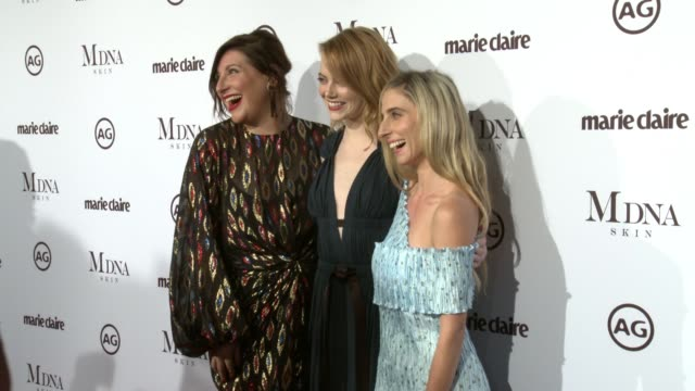 Rachel Goodwin Emma Stone and Mara Roszak at the Marie Claire's Image Maker Awards 2018 at Delilah on January 11 2018 in West Hollywood California