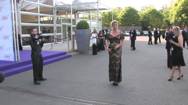 rachel hunter arrives for the caudwell butterfly ball held at evolution, battersea park, london. at the celebrity sightings in london at london... - レイチェル ハンター点の映像素材/bロール