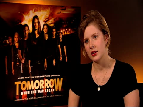 vídeos de stock, filmes e b-roll de rachel hurdwood on the next film rachel questions reporter at the tomorrow when the war began interview at london england - ocupação na mídia