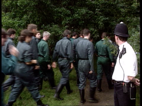 Man freed on police bail ITN SW London Wimbledon CommonMS Police searching for evidence PAN LR Police crawling thru trees MS SIDE Ditto CMS...