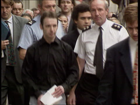 Police justify actions ITNLIB ENGLAND London Old Bailey Colin Stagg surrounded by police and reporters leaving Old Bailey walking twds TLMS Stagg...