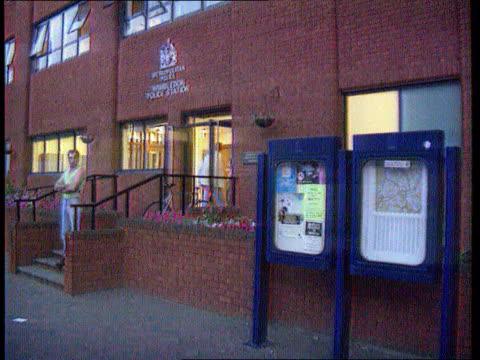 Police justify actions ITNLIB ENGLAND London Wimbledon Wimbledon Police Station