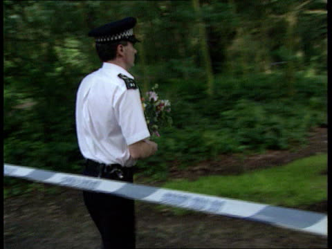 Rachel Nickell murder trial collapses ITN London Wimbledon MS Police officer laying flowers at site of murder ITN MS Police searching CMS Ditto