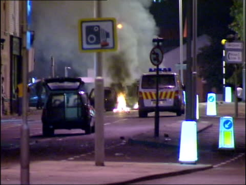 man victim of a hit and run attack; itn england: lancashire: burnley ext cbv police in riot gear away along road past mounted police officers riot... - sidewalk gutter stock videos & royalty-free footage