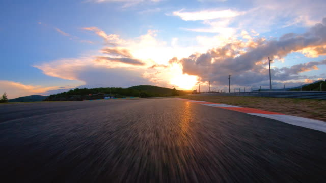 racing at sunset - sports track stock videos & royalty-free footage