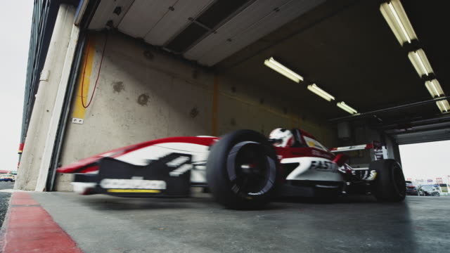 racing car leaving a garage - gate stock videos & royalty-free footage
