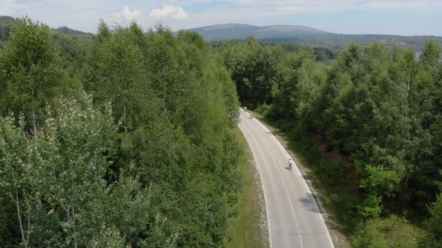 racing cyclists on road - medallist stock videos & royalty-free footage
