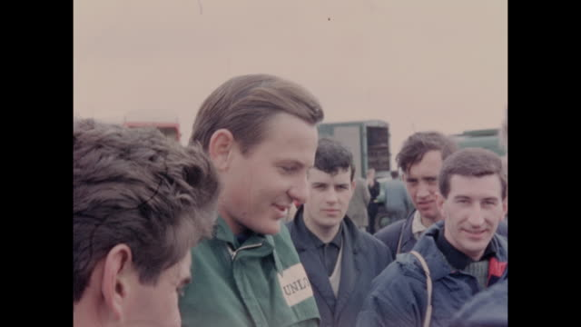racing driver bruce mclaren of new zealand signing autographs after winning a race during the international trophy meeting at silverstone circuit in... - silverstone stock videos & royalty-free footage