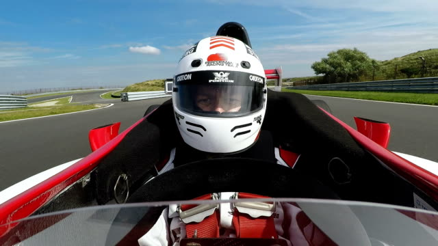 racing driver in cockpit steering formula one car - pursuit sports competition format stock videos and b-roll footage