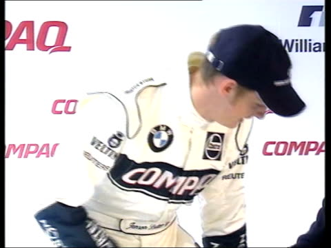 vídeos de stock, filmes e b-roll de lib racing driver jenson button taking seat for press conference by the bmw williams formula one team pan regents street ext cms button signing... - autografando