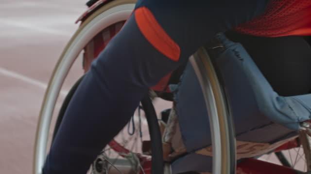 racing on wheelchair - 障がい点の映像素材/bロール