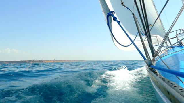 racing sailing yacht (slow motion)