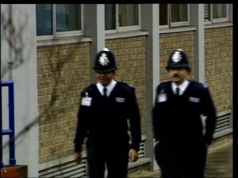 stockvideo's en b-roll-footage met racism in metropolitan police lib ext gv police recruits walking outside hendon lms two male police recruits from ethnic minority walking along ls... - rekruut