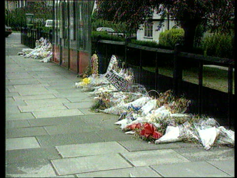 racist attacks/ stephen lawrence murder lib flowers laid at busstop where lawrence was murdered - bus stop stock videos & royalty-free footage