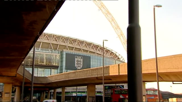 stockvideo's en b-roll-footage met racist chants at tottenham match; r03021214 / wembley stadium: ext 'the fa' sign and logo on side of wembley stadium - english football association