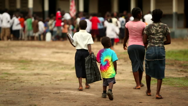 Rack focus African schoolchildren in Liberia