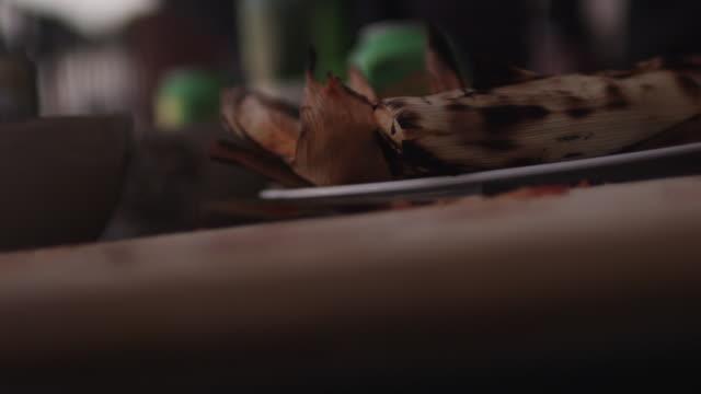 Rack focus, cutting board in kitchen