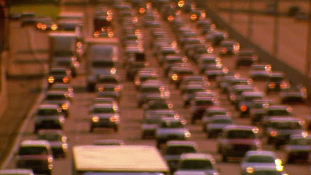 Rack focus medium shot traffic jam on highway