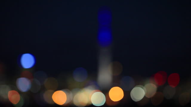 rack focus night cityscape with sky tower, auckland, new zealand, - rack focus stock videos & royalty-free footage