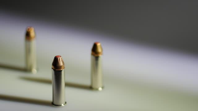 rack focus of bullets - fem objekt bildbanksvideor och videomaterial från bakom kulisserna