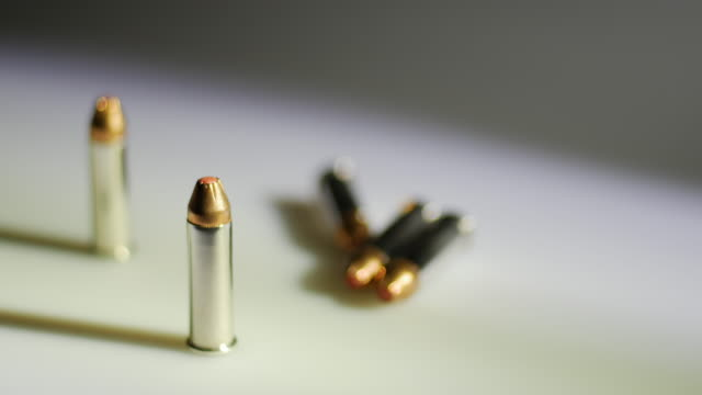 rack focus of bullets - fünf gegenstände stock-videos und b-roll-filmmaterial