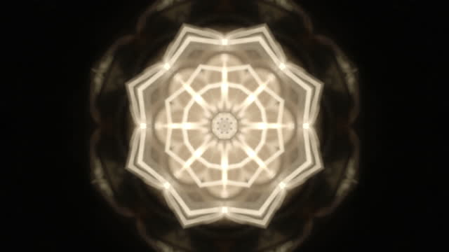 rack focus on a light bulb causing a kaleidoscope effect - kaleidoscope pattern stock videos & royalty-free footage