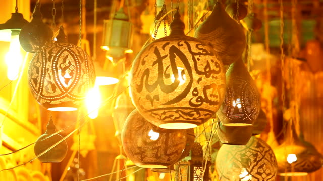 Rack focus Patterned hanging lanterns in a night market/ Cairo/ Egypt