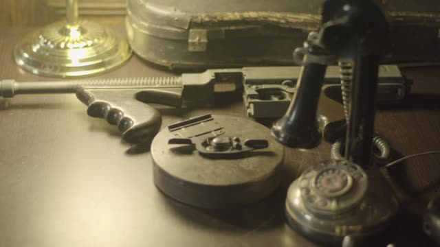 rack focus shot of a disassembled thompson submachine gun on a desk - submachine gun stock videos & royalty-free footage